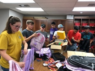 NHS Students filling backpacks